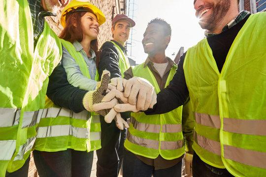 Group logistics worker stacks hands