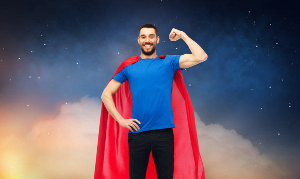 power and people concept - happy man in red superhero cape over night sky background