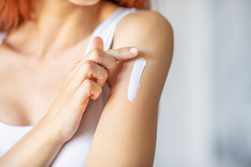 Woman applying hand cream - stock photo