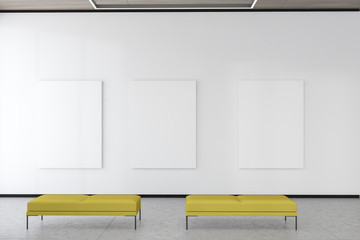 Three mock up posters in white gallery interior