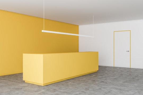 Yellow reception desk in yellow office corner