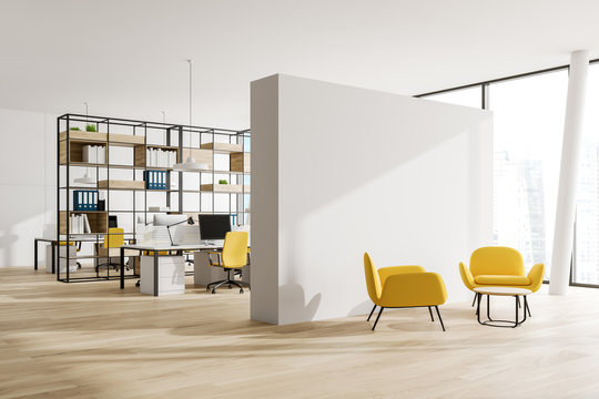 White open space office corner with lounge