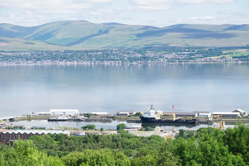 Aerial view of Greenock shipbuilding crane and Gourock ships at the coastal town from above