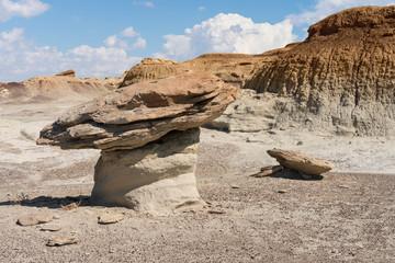 Hoodoo Rock Formation in Desert Landscape