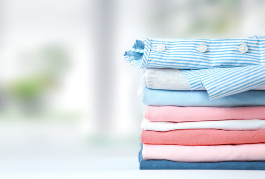 Colorful cotton stack pf clothing empty space background.
