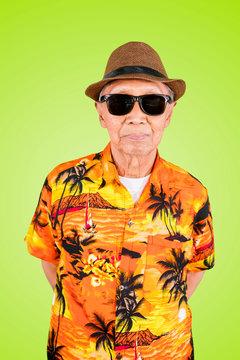 Senior man wears summer clothes on studio