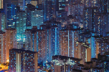 Aerial view of Hong Kong Downtown, Republic of China. Financial district and business centers in technology smart city in Asia. Top view of skyscraper and high-rise buildings at night. Fototapete