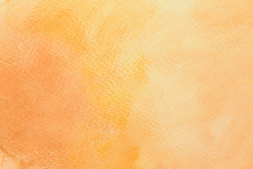 Abstract mixed gradient brown, orange and yellow watercolor on paper. The color splashing in the paper. It is a hand drawn.