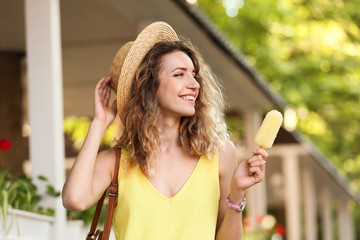 Happy young woman with delicious ice cream outdoors Fototapete