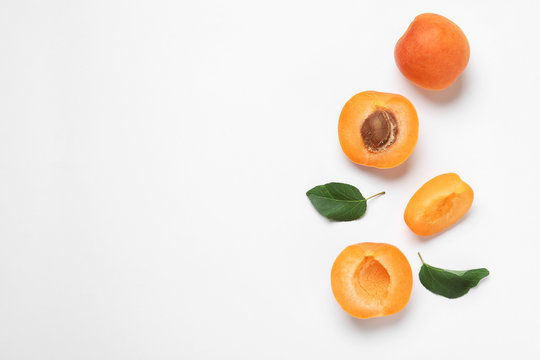 Delicious ripe sweet apricots on white background, top view