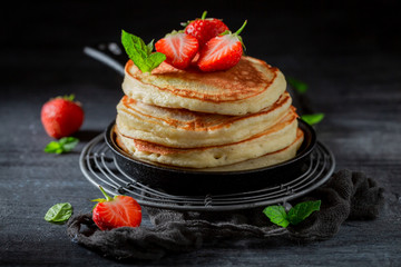 Homemade american pancakes with fresh sweet strawberries and sugar