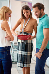 Couple with saleswoman in store for household.