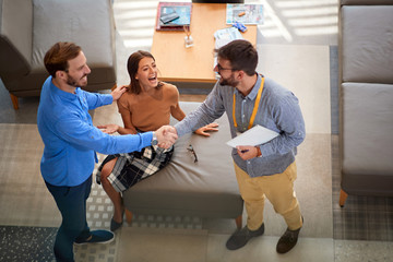 Couple with salesman in store furniture for the house.