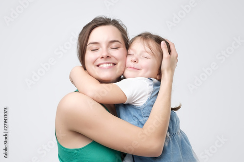 Woman hugging her cute child baby girl. Mother Day love family, parenthood childhood concept