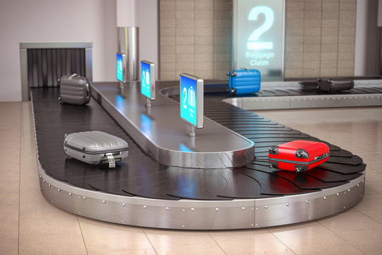 Suitcases on the airport luggage conveyor belt. Baggage claim. Airport terminal.