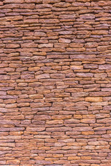 Traditional stacked stone wall in an historic buuilding/