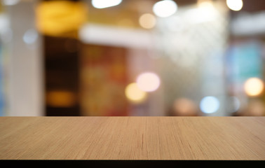 Empty dark wooden table in front of abstract blurred bokeh background of restaurant . can be used for display or montage your products.Mock up for space. Wall mural