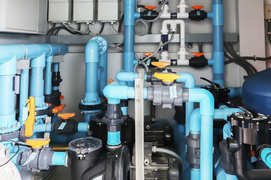 Image background of inside mechanical room of pipeline system for swimming pool.
