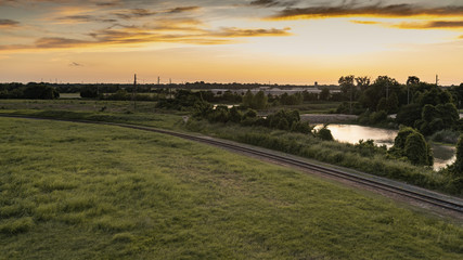 Sunset in Sugar Land, Texas with a view of the creek and railways