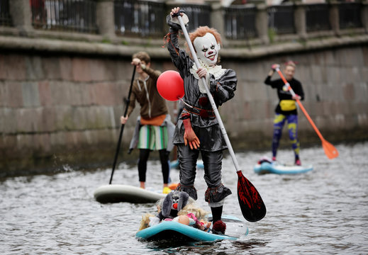 Paddlers take part in the Fontanka-SUP stand up paddle boarding festival inSaintPetersburg