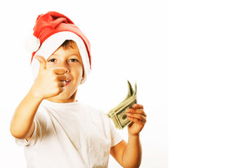 little cute boy in santas red hat isolated with cash american dollars thumbs up happy kid holiday celebration