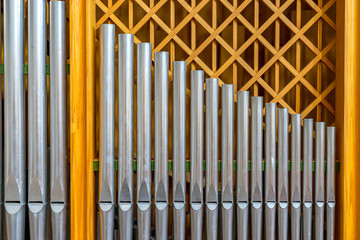 High-quality silver organ pipes in golden frame, background, symbol picture