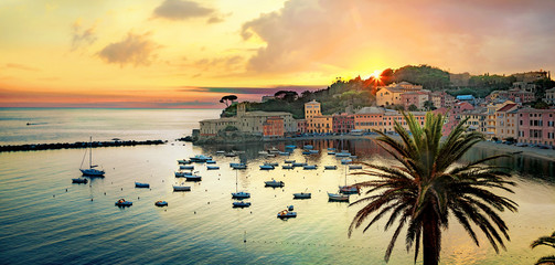 Silence bay and seaside of small resort town Sestri Levante at sunset. Genova Province, Liguria, Italy