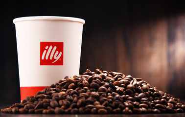 Composition with paper cup of Illy coffee and beans