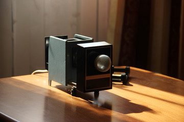 Film-viewing device slide projector lay on the table