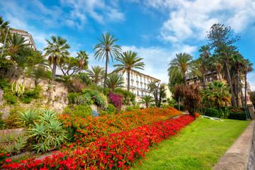 Coastal colorful street with flowers lawn in San Remo. Liguria, Italia