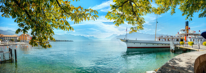 Wall Mural - Landscape with wharf and touristic old ferry on Geneva Lake in Vevey town. Vaud canton, Switzerland