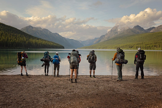 group of hikers ready to hike around Bowman lake in Montana, Glacier National Park
