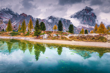Wall Mural - Beautiful alpine lake with snowy peaks in background, Dolomites, Italy
