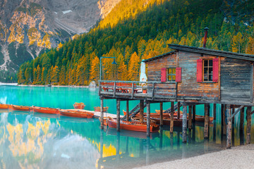 Wall Mural - Cute wooden boathouse on the alpine lake, Dolomites, Italy, Europe