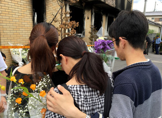 People visit the Kyoto Animation building which was torched in an arson attack, in Kyoto