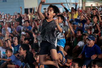 Filipino boxing fans react as they watch the WBA Welterweight match between Philippine boxing icon Manny Pacquiao and Keith Thurman of the U.S. in a live public viewing in Marikina