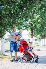 Aluminium Prints Indonesia father performs parental duties, stroller, summer, caucasian family