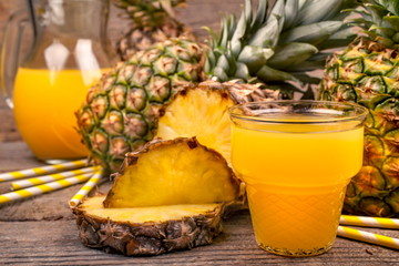 freshly squeezed juice of pineapple on a rustic background