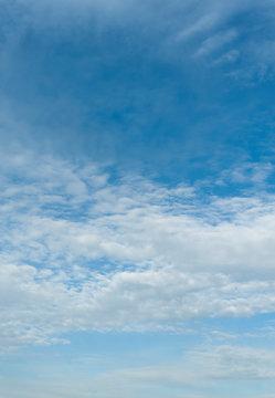 Beautiful spring blue sky with clouds altocumulus in Fuji City, Japan. Vertical shot.