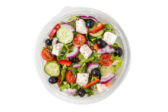 Fresh greek salad in a plastic package to take away for lunch isolated on white background
