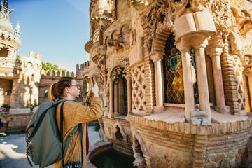 Woman tourist photographing Castillo de Colomares
