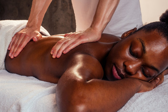 afro american female getting neck massage.