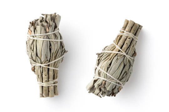 white sage smudge sticks used for spiritual incenses isolated on a white background, two different positions, top view
