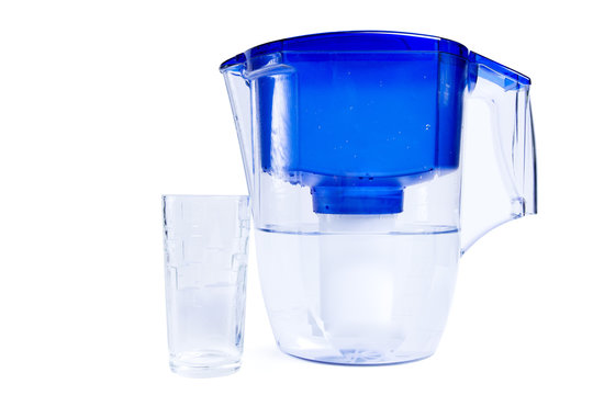 Water filter jug and glass cup isolated on white