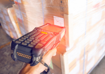 worker hodling barcode scanner is scanning label product.