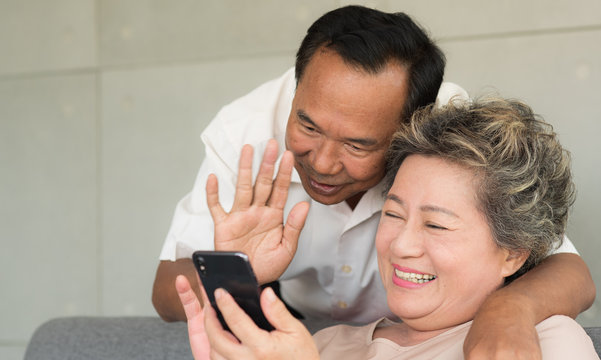 Senior Asian wife and husband use video call to son or daughter with happy smiling face,  Warm family