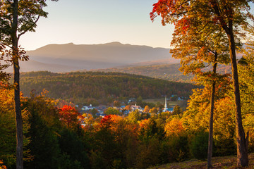 Overlooking a peaceful New England village in the autumn at sunset.