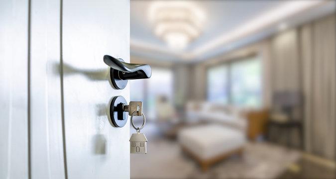 Open door with keys, key in keyhole