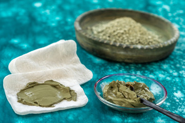Clay Spa and medical concept: Clay Poultice Use It to Relieve Inflammation,for abscess,cyst,arthritis,Skincare benefit, blue background
