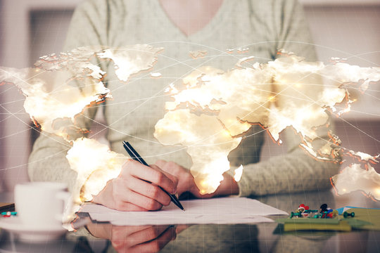 International business hologram over woman's hands taking notes background. Concept of success. Double exposure